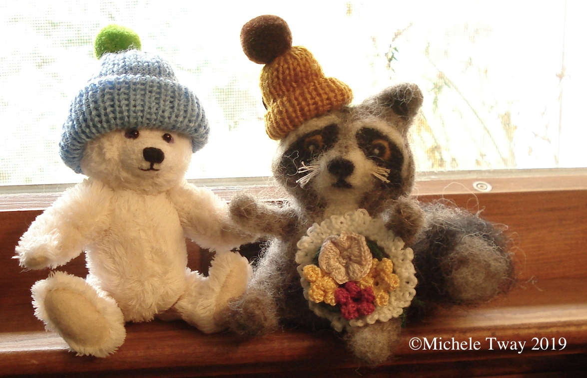 Carol's hats on Michele's bear and racoon
